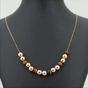 14 Kt Solid Gold and Tiger eye necklace